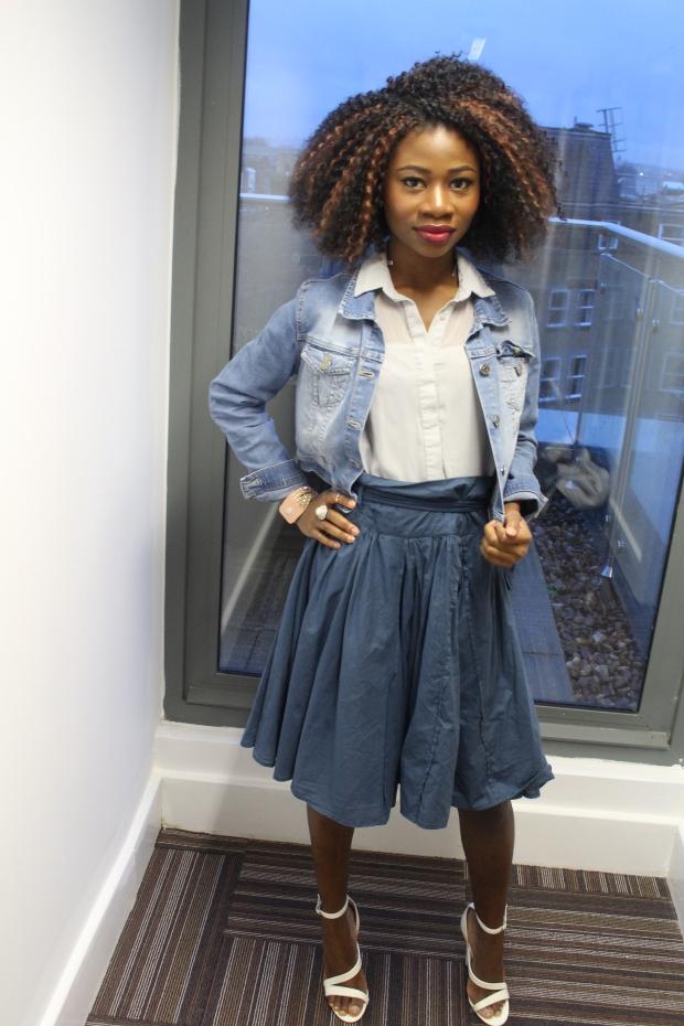 Blue paper bag skirt, washed blue jean jacket, grey blue blouse, white heels,crochet braids