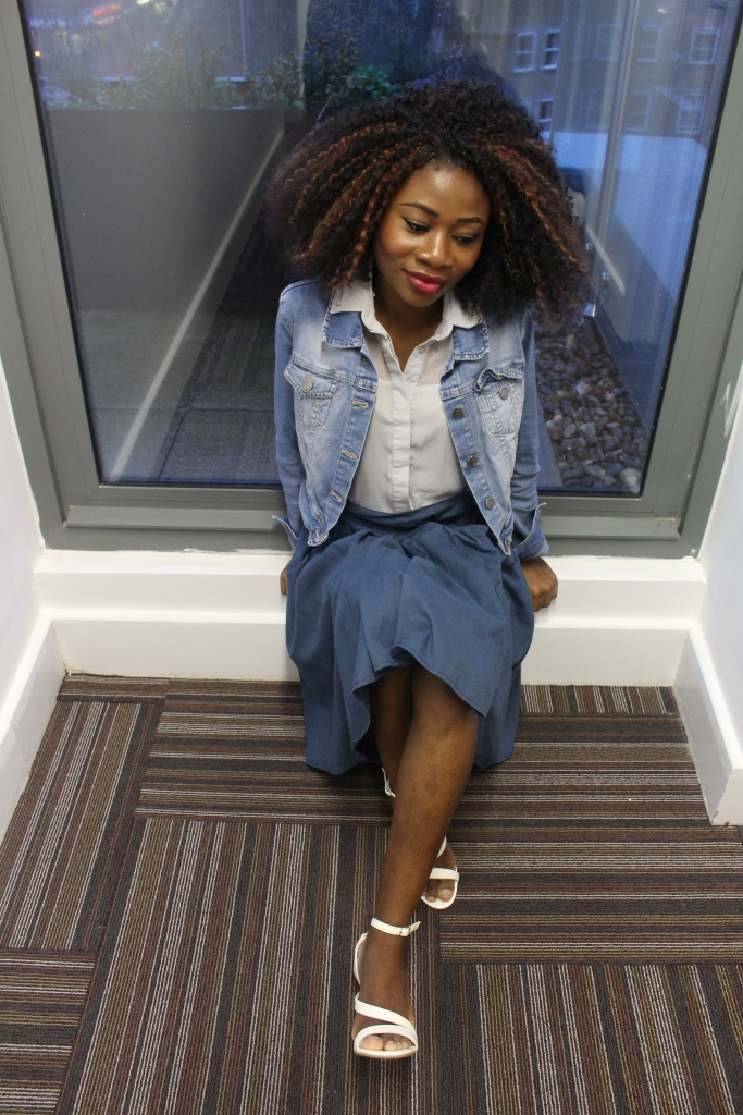 Blue paper bag skirt, washed blue jean jacket, grey blue blouse, white heels,crochet braids