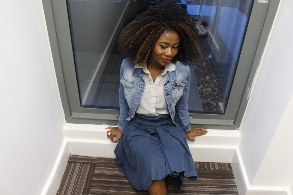 Blue paper bag skirt, washed blue jean jacket, grey blue blouse, white heels,crochet braids, girl sitting on the floor, thinking, OOTD