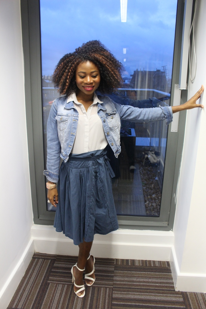 Blue paper bag skirt, washed blue jean jacket, grey blue blouse, white heels,crochet braids, confident