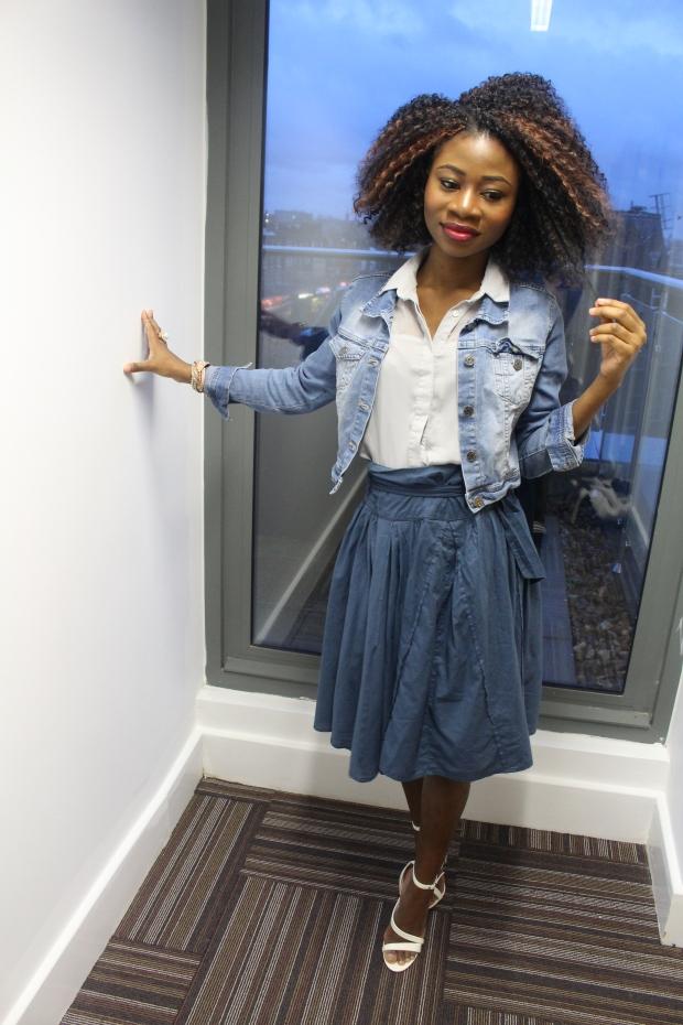 Blue paper bag skirt, washed blue jean jacket, grey blue blouse, white heels,crochet braids, confident